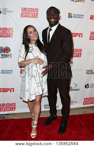 NEW YORK, NY-JUNE 3: New York Giants football player Prince Amukamara (R) and wife Pilar Davis attend the 2015 Up2Us Sports Gala at IAC Building on June 3, 2015 in New York City.