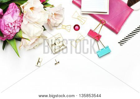 White Desk, Pink & Peonies, Styled desktop. Flat lay. Peonies on the white background, view table. Up desk, stationery with notebook