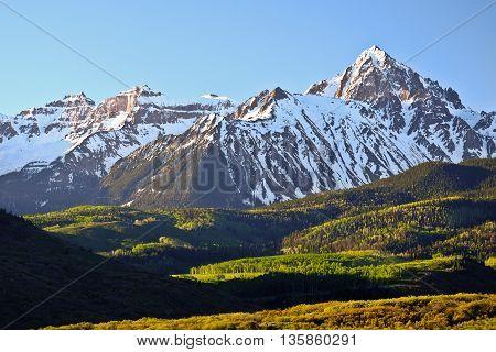 Sunrise Illuminates the High and Snowy Peak of Mt Sneffles.  Rocky Mountains, Colorado, USA.