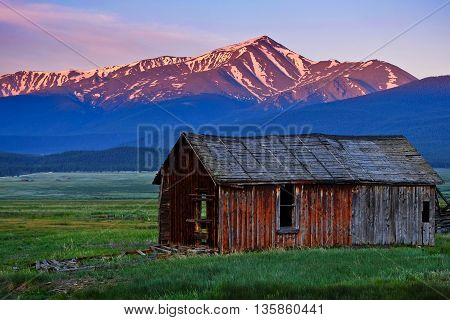 Sunrise Illuminates Colorado's Tallest Peak and Old Barn.  Mt Elbert, Rocky Mountains, Colorado, USA.