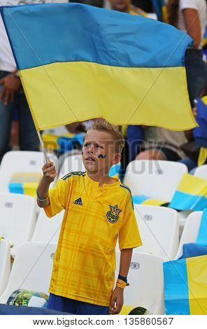 MARSEILLE FRANCE - JUNE 21 2016: Young ukrainian fan shows his support during the UEFA EURO 2016 game Ukraine v Poland at Stade Velodrome in Marseille