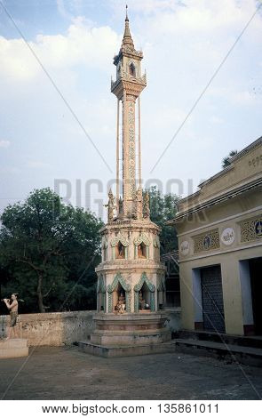 PAGAN / MYANMAR - CIRCA 1987: A tower with sculptures in the courtyard of a Buddhist temple in Pagan.