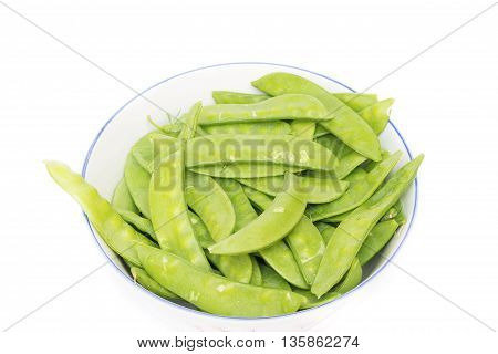 Green peas in a bowl, sugar Pea, Sweet peas, Garden Pea, snow peas on white background.