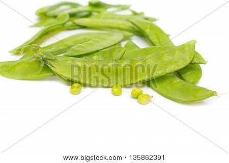 fresh green peas, sugar Pea, Sweet peas, Garden Pea, snow peas, seed peas, Pea pale on white background, and Blur blurred the background. select focus front nuts.