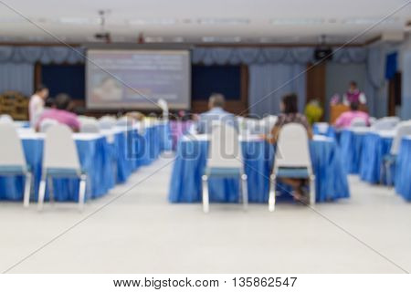 blur blurred abstract at Business education training conference hall or room seminar meeting People Analyzing Statistics Financial Concept with attendee background.