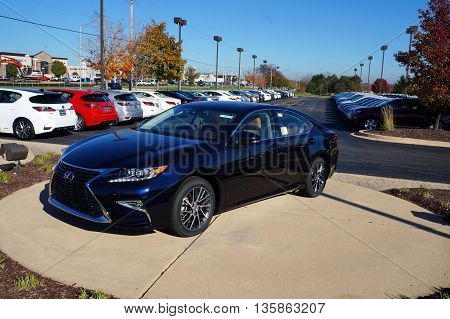 NAPERVILLE, ILLINOIS / UNITED STATES - NOVEMBER 3, 2015: A blue luxury sedan is on display on the lot at Lexus of Naperville.