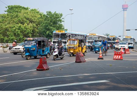 COLOMBO, SRI LANKA - MARCH 26, 2015: Traffic on the street of Colombo. Cars and motorcycles driving through the central part of Colombo during rush hour