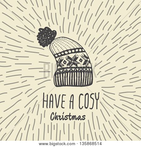 Christmas vintage card with with hand drawn knitted winter hat and text 'Have a Cosy Christmas'. Vector hand drawn illustration on beige background.