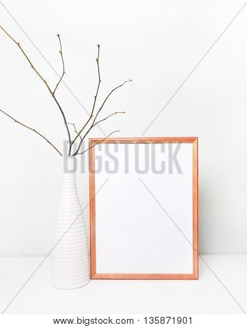 Frame mock up white wall and wood frame. Template poster place work. Mock up wedding sign