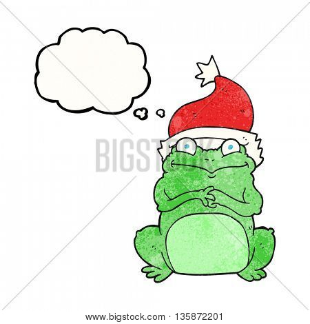 freehand drawn thought bubble textured cartoon frog wearing christmas hat