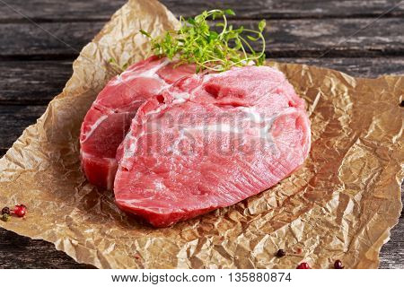 Fresh Raw Pork Shoulder on scrumbled paper.