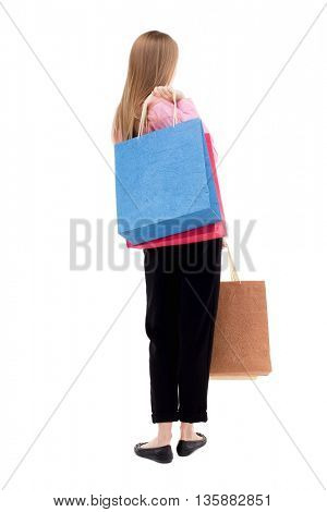 back view of woman with shopping bags . beautiful brunette girl in motion.  backside view of person. Isolated over white background. The girl in the pink shirt is throwing shoulder bag with purchases.