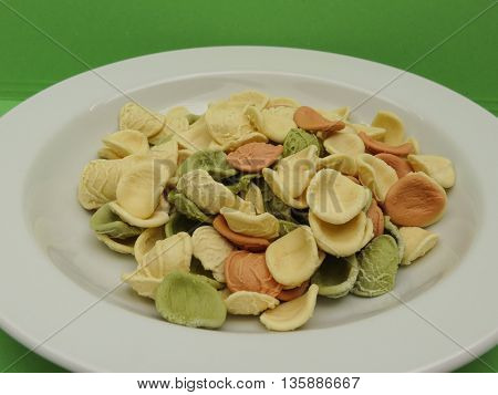 Orecchiette pasta from Apulia Italy in three colours (natural spinach green beetroot red)