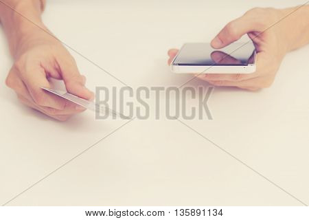 Online Payment, Hands Holding A Credit Card And Using Smart Phone For Online Shopping