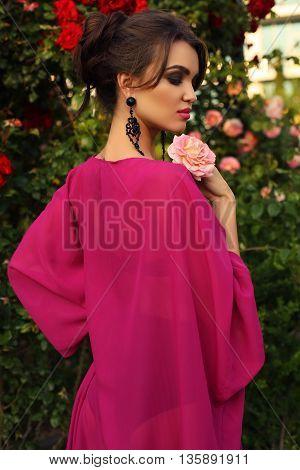 Gorgeous Sensual Woman With Dark Hair In Elegant Dress
