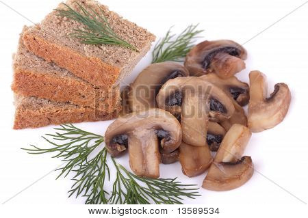 Fried mushrooms (champignons) and rye bread with dill isolated on white background