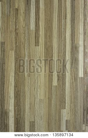 Brown wooden board the background a wall surface.