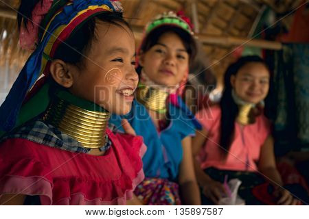 CHIANG MAI, TAILAND - APRIL 22, 2016: A portrait of a girl from Kayan Lahwi tribe known for wearing neck rings, brass coils to extend the neck. Kayan, Red Karen (Karenni).
