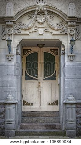 An art deco style entrance painted green situated in the Swedish town of Malmo.