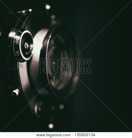 Retro view camera lens with vintage shutter abstract techno backgrounds. Grungy texture