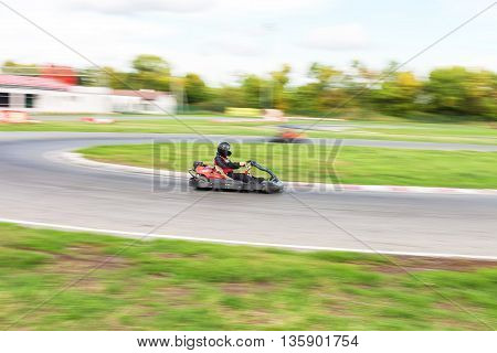 Races on kartings. Man and Karting. Cars races.