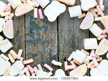 Set of traditional American fluffy candy marshmallow blank space for text in frame of marshmallow top view
