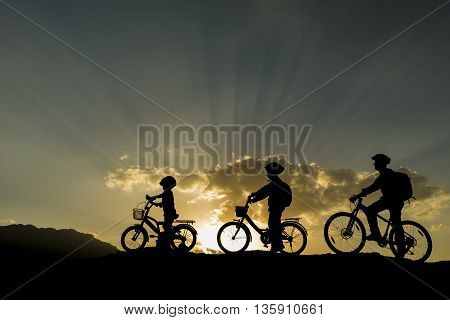 silhouette of the cyclist of the team.arbitrary in nature adventure