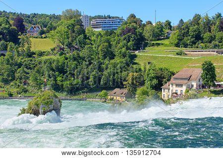 Neuhausen am Rheinfall, Switzerland - 22 June, 2016: the Rhine Falls. The Rhine Falls is the largest plain waterfall in Europe, located on the Rhine river in Switzerland.