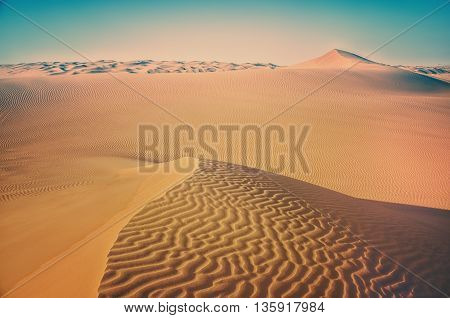 Desert landscape.Background desert landscape.Dunes of the desert.Waves sand on top of the dunes.Sand desert. Desert dunes sunset landscape.