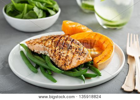 Grilled blackened salmon fillet with grilled butternut squash