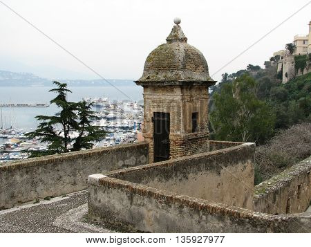 A sentry tower overlooking a beautiful European harbor