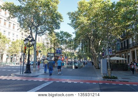 Barcelona Spain - August 28 2015: Passeig de gracia view with people the most turistic street from city