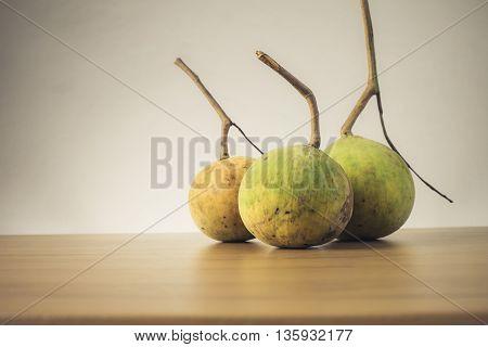 Santol fruit on wooden table - Still life