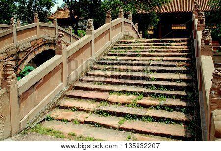 Deyang China - July 6 2007: Lions balustrades decorate the Pan bridges at the Deyang Confucian Temple