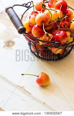 Sweet Cherries On Rustic Table