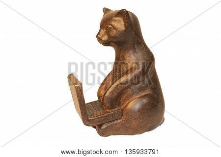 wooden cat sits at a laptop on a transparent background