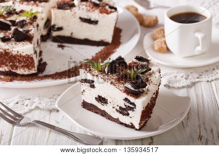 Tasty Cheesecake With Pieces Of Chocolate Cookies Close-up And Coffee. Horizontal