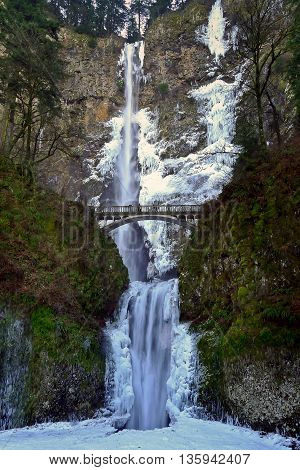 Frozen Waterfall and Bridge.  Multnomah Falls, Columbia River Gorge, Oregon, USA