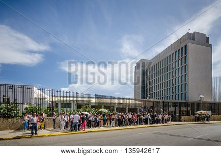 HAVANA, =- CUBA  JUNE 20, 2016: People line up outside the Embassy of the United States of America for consular services. The embassy was reopened when the United States and Cuba renewed diplomatic relations on July 20, 2015.