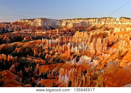 Sunrise Illuminates Bryce Canyon.  Bryce Canyon National Park, Utah, USA