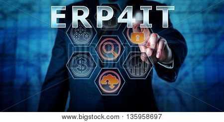 Male enterprise manager is pressing ERP4IT on a transparent virtual touch screen interface. Business management concept and IT terminology for Enterprise Resource Planning For Information Technology.