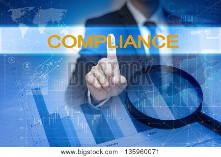 Businessman hand touching COMPLIANCE button on virtual screen poster
