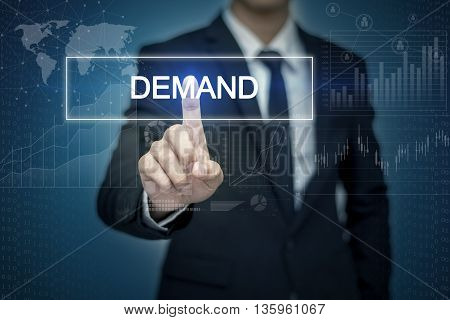 Businessman hand touching DEMAND button on virtual screen