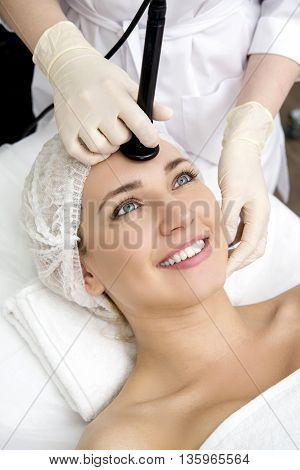 Young pretty woman receiving treatments in beauty salons.