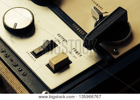 Knobs buttons and rollers of old tape recorder open