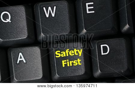 safety first concept with yellow key on computer keyboard