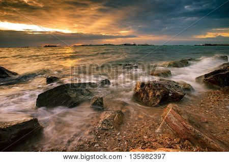 beautiful sun set sky at sea coast in laem chabang chonburi eastern of thailand