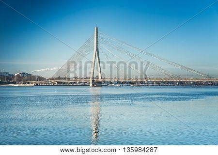 A view of the Vansu bridge over Daugava River in Riga, Latvia at winter