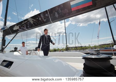 ST. PETERSBURG, RUSSIA - JUNE 4, 2016: Chairman of the Management Committee of Gazprom Alexey Miller on the yacht Bronenosec participating in Nord Stream Race. Five teams compete in the race this year