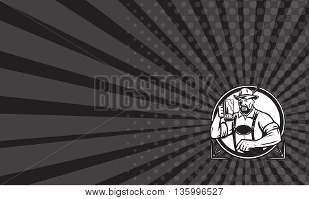 Business card showing Black and white illustration of a German Bavarian beer drinker raising beer mug for Oktoberfest toast wearing lederhosen and German hat set inside circle done in retro style.